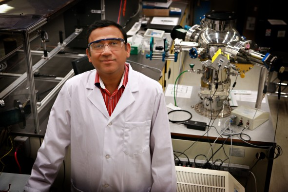 University of Utah materials science and engineering associate professor Ashutosh Tiwari stands in his lab where he and his team have discovered a new 2D semiconducting material made of tin and oxygen. This new material allows electrical charges to move through it much faster than common 3D material such as silicon. This breakthrough in semiconductor material could lead to much faster computers and mobile devices such as smartphones that also run on less power and with less heat.