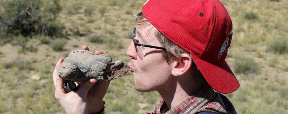 Adam Huttenlocker identifies a small therapsid fossil at one of the study sites.