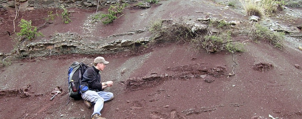 Adam Huttenlocker taking samples at the top of the Permian at one of the study sites.