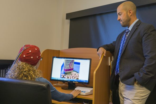 The University of Utah College of Social Work Assistant Dean Dr. Eric Garland in his lab with a graduate student.