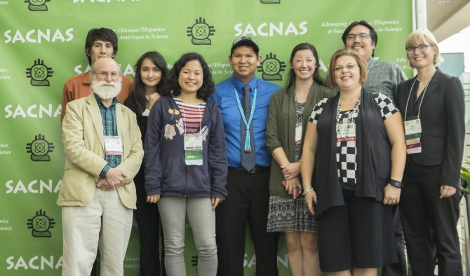 Luis Vidal, second from left, with several members of the Utah State University SACNAS chapter attending the conference.