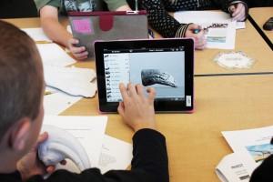 A student manipulates a virtual 3-D model of a bone.