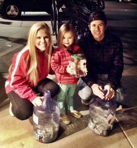 Taylor Dalebout and Brady Donaldson with a young Utah fan at Rice-Eccles Stadium collection day.