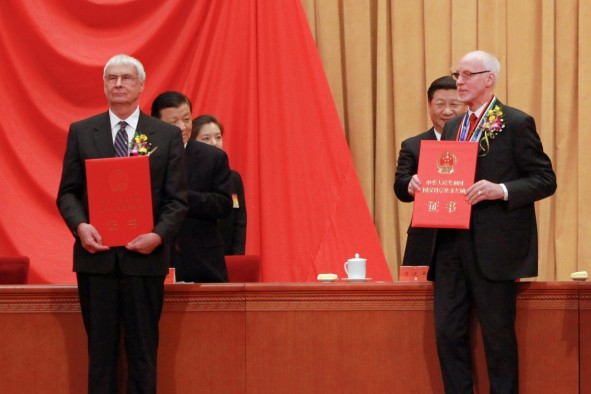 University of Utah chemist Peter J. Stang (left) and Swedish scientist Jan-Christer Janson on stage Jan. 8, 2016, in the Great Hall of the People in Beijing, as they accept China's International Science and Technology Cooperation Award. They were among seven winners. Chinese President Xi Jinping stands behind Janson on the right, while standing behind Stang are Liu Yunshan, first-ranked Secretary of the Central Secretariat of the Communist Party of China, and a staff member.