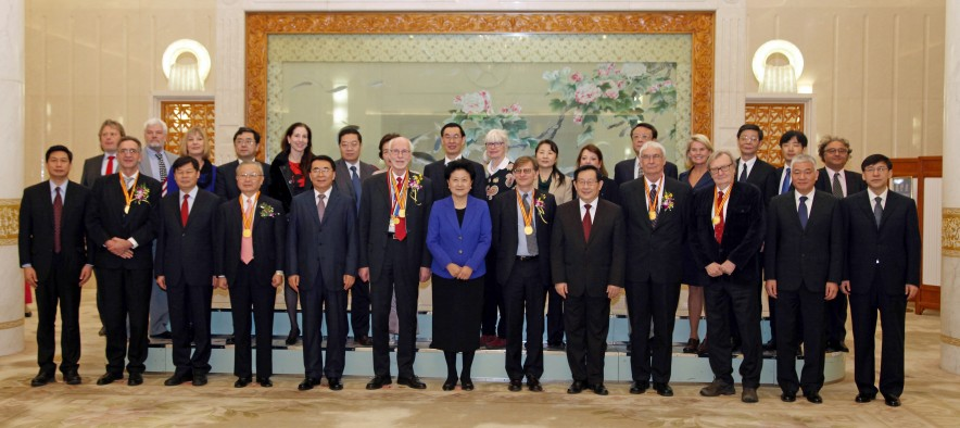 University of Utah organic chemist Peter J. Stang (front row, fourth from right) stands with other winners (wearing gold ribbons with medals) of China's International Science and Technology Cooperation Awards and a number of officials in the Great Hall of the People in Beijing on Jan. 8, 2016. At center in blue jacket is Liu Yandong, vice premier of the People's Republic of China.