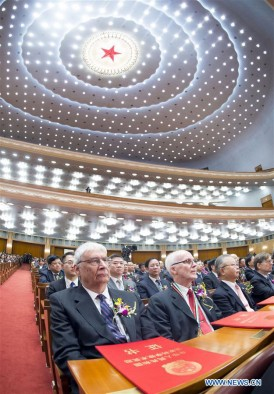 University of Utah chemist Peter J. Stang (on aisle) sits in China's Great Hall of the People on Jan. 8, 2016, during a ceremony in which he was awarded that nation's International Science and Technology Cooperation Award.