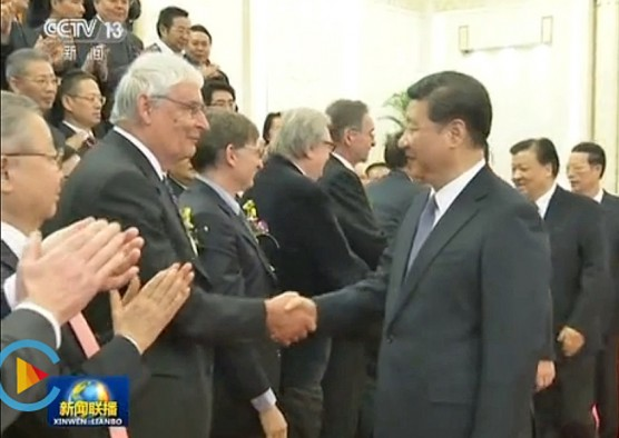 After receiving and International Science and Technology Cooperation Award on Jan. 8, 2016, in China's Great Hall of the People, University of Utah chemist Peter J. Stang, left, shakes hands with Chinese President Xi Jinping.