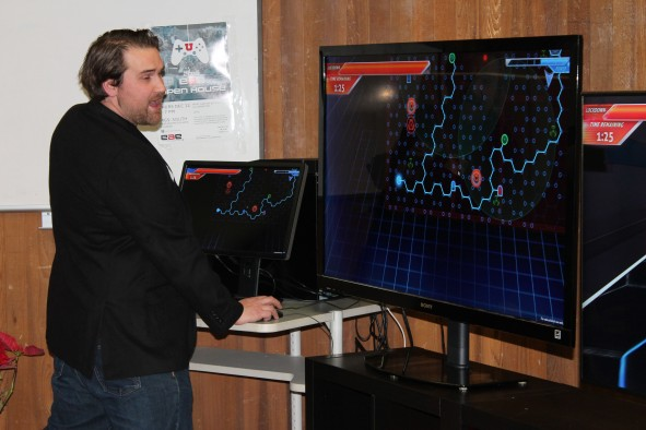 A.J. Dimick, a former student with the University of Utah's Entertainment Arts & Engineering video game development program, shows off a video game he helped produced. The University of Utah's No.1- ranked video game program, Entertainment Arts & Engineering (EAE), and the David Eccles School of Business announce the creation of the nation's first dual master's degree combining a Master of Business Administration with a Master in EAE in game development. This unique degree for graduate students is designed to prepare them for all facets of the growing $91 billion video game industry, from designing and producing games to publishing them in a competitive market.