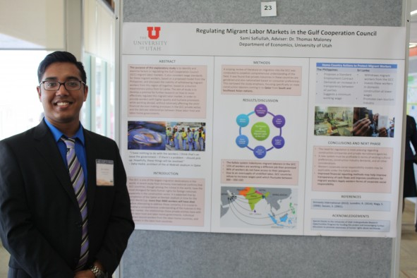 2015 UCUR presenter and U alumnus Sami Safiullah stands in front of his poster.