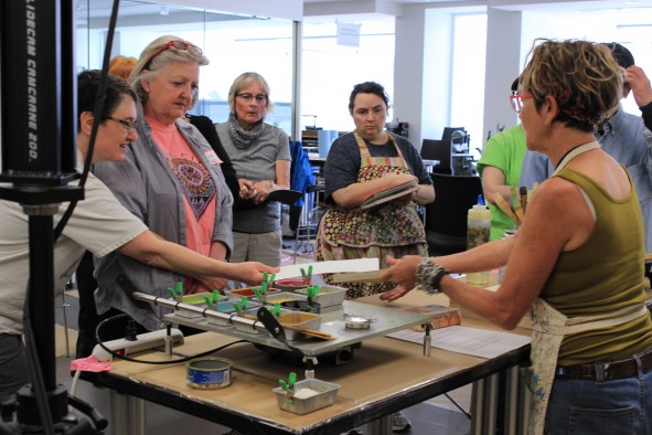 Workshop participants get hands-on experience and learn from experts in book arts and printmaking.