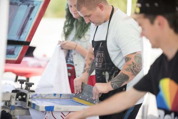 Art & Art History alumnus, Brian Taylor, screen printing at Arts Bash