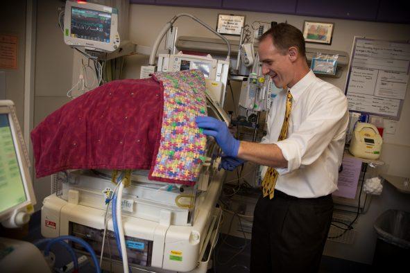 Christian Con Yost, M.D., associate professor of pediatrics at the University of Utah School of Medicine in the neonatal intensive care unit (NICU).